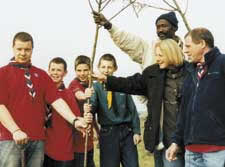 Plantring a tree on behalf of the Scouts Ghambia Link