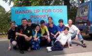 Hands up for God puppet show team